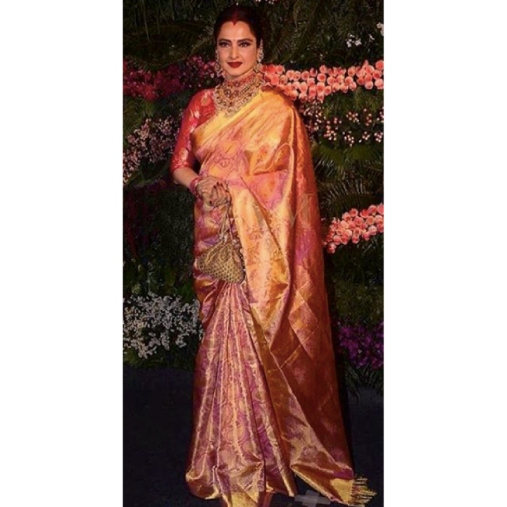 Rekha at Virushka.png